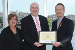 Kyle Hamilton (right), chief executive officer of Our Sunday Visitor, accepts the Volunteer/Company of the Year Award from Ron Turpin (center), chair of the Indiana United Way board of directors, and Diane Brumbaugh (left), office and events administrator of the United Way of Huntington County.