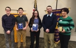 Nickolas Mickley and Olivia Godfroy, students at Huntington Catholic School, are recipients of Youth Appreciation Awards from the Huntington Optimist Club. Shown during the Feb. 16 presentation are (from left) Matt Ditzler, president of the Huntington Optimist Club; Mickley and Godfroy; Derek Boone, Huntington Catholic School principal; and Juanita Mejia-Goodwell, northeast Indiana outreach manager for the Indiana Youth Institute.