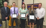 Members of the Huntington Optimist Club congratulate the winners of three scholarships, presented at its meeting on May 19. Pictured are (from left) Marshall Sanders, Optimist scholarship committee chair, scholarship recipients Ian Kimmel, Tosha Davis and Carly Snyder, and Optimist Club President Tim Allen.