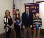 The Huntington Optimist Club has presented its Youth Appreciation Awards to Crestview Middle School students Macy Wohlford and Corbin Cozad. Pictured are (from left) Ruth Marsh, Optimist Club president; Wohlford; Crestview Principal Chuck Werth; and Cozad.