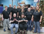 Employees working with the new Independent Scents candles line, a part of Pathfinder Services' Outsource Manufacturing Division, show off their finished products. Pictured are (front row from left) Tommy Marshall and Elizabeth Koehl; (second row from left) Trevor Whitesell, Bret Seslar, Crystal Waters, Jodie Scher and Alicia Landrum; and (back row from left) Mike Overholser, Ryan Thomas, Kurtis Grodrian, Joel Harrell, John Baker and Sheryl Rea.