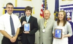 Huntington Catholic School Principal Jason Woolard (left) is shown with (from left) Conner Kreider, Kiwanis Past Lt. Gov. Jim Dinius and Mary Simms. Simms and Kreider were honored by the Huntington Metro Kiwanis Club as outstanding eighth-graders.