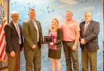 John Sampson (left), president and CEO of the Northeast Indiana Regional Partnership, presents permitting excellence awards to members of the City of Huntington Community Development and Redevelopment Department including (from left) Director Bryn Keplinger, Miranda Snelling and Shad Paul, along with Mayor Brooks Fetters (right).
