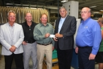 Thomas Allred (third from left), assistant vice president of PHD, Inc. Huntington Operations, accepts a check in the amount of $28,000 in CEDIT funds from Huntington County Commissioner Tom Wall, in support of the company's Phase 2 expansion project. Celebrating the occasion are (from left) Commissioner Rob Miller, Commissioner Larry Buzzard, Allred, Wall and PHD Controller Mark Searles.