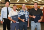 Three retirees were honored for their service to the Huntington branch of the U.S. Postal Service with a presentation and carry-in reception on Friday, Aug. 21. Pictured (from left to right) are Postmaster David Kuehnert and retirees Jack Abbott, Gary Oswalt and Geoffrey Guy.