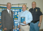 Det. Sgt. Chad Hacker (center) receives the Officer of the Year award from Huntington Noon Kiwanis Club President Erv Ebersole (left) and Huntington Police Chief Tom Emely.