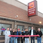 Ivan Gomez (third from right), the owner of the new Markle's Pancake House, prepares to cut the ribbon on Friday, March 29. Celebrating the occasion are (from left) Chad Yoder of the Markle Chamber of Commerce; restaurant employees Ariel King, Jessica Tappy, Susan Ellett, Rene Olivares, Juan Ortega and Jonathan Gomez; Gomez; Markle Town Councilman Aaron McClary; and Mark Schaufelberger of the Markle Chamber of Commerce. The eatery is located at 165 N. Clark St.