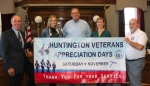 Bruce Stanton (center) will be the 2015 Veterans Day Parade grand marshal. He recently retired as the Huntington County veterans service officer. Congratulating him on Wednesday, Oct. 7, are (from left) Steve Kimmel, Huntington County Chamber of Commerce; Veterans Service Office Assistant Taryn Fusselman; Stanton; Veterans Service Office Intern Edith Runion; and Huntington Mayor Brooks Fetters.