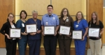 Parkview Huntington Hospital co-workers (from left) Asheley Chaney, Susan Funk, Debra Stallsmith, Tom Wigner, Dawne Thieme, Jackie Geiger and Kim Case share the recognition received from the Professional Research Consultants (PRC) Excellence in Healthcare Awards.