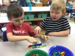 Kameron Turley (left) and Terry Saulmon are shown in the Pathfinder Kids Kampus preschool room. As an On My Way Pre-K Provider, the early education facility will provide free preschool to 10 4-year-old children for the 2017-18 school year.
