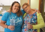 Pathfinder Kids Kampus teachers Michelle Borne (left) and Nondus Christman show off the tumblers they recently received during Teacher Appreciation Week at the facility.
