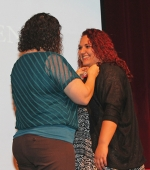 Huntington North High School student Kaitlin Aughinbaugh (right) is all smiles as she receives her Certified Nurse Aide pin from CNA instructor Stephanie Shady during the pinning ceremony held Wednesday, May 25, in the HNHS auditorium. Twenty-two students took part in the ceremony.