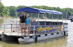 Randy (left) and Debbie Yarger, owner of Pirate's Cove Marina at Salamonie Reservoir, are offering tours of the reservoir aboard this covered pontoon boat.