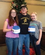 Tim Godfroy (center), co-chairman of the Huntington Knights of Columbus Pitch-In, prepares for this Saturday's event with help from Olivia Godfroy (left) and Lindsay Godfroy.