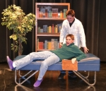 "Robert Borland (standing), in character as psychiatrist Dr. Sycho, frightens his new assistant, William Borland, with his crazy methods. The Borland brothers, along with Kylie Frederick, star in ""The Three-Step Method,"" one of the acts to be presented during the One-Act Play Festival Jan. 29 and 30 at Huntington North High School."