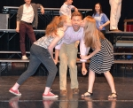"Tyler Gates gets smooches from each side, with Rebecca Short on the left and Grace Dimond on the right, during a scene from ""Saturday Night Fever."" The musical will be performed on the Huntington North High School stage May 4, 5 and 6."
