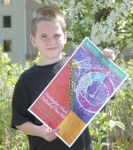 Chase Keirn, a fourth-grader at Lincoln Elementary School, holds a poster advertising ArtsExpress 2010.