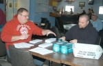 Dusty Ransom (left) and Cory Campbell, members of American Legion Post 7, prepare letters being sent out seeking contributions to help stage the 2010 Fourth of July fireworks display.