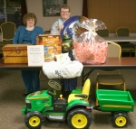 Jennifer Allmandinger (left), co-chair of the local ESA Internationl spaghetti supper and auction on Thursday, Oct. 29, and Carmen Oswalt, Ways and Means committee, are shown with some of the items that will be auctioned off during thelive auction.