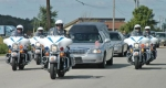 Indiana State Police motorcycle officers escort a hearse carrying the body of Spc. Chad Clements down Flaxmill Road on Wednesday, Sept. 8. Clements was killed by a roadside bomb on Aug. 30 while serving in Afghanistan.