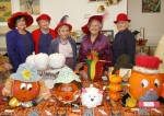 """Members of The Real Elegant Dames Red Hatters, of Warren (from left) Christine Knox, Joyce Shepherd, Marian Hoffman, Queen Mum Lilly Nutter and """"Freddie"""" Couch were the judges for the fifth annual Great Pumpkin Festival Pumpkin Decorating Contest."""
