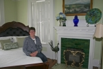 Proprietor Barb Fetters relaxes in one of the guest rooms in the new Purviance House Bed and Breakfast, which opened for business May 15. The historic home has two rooms available for guests with a third to be opened soon.