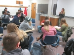Megan Friesen, a member of the Active Living council, fields responses for Huntington University students about questions she posed to them regarding the parent discussion group meetings to be held at Crestview Middle School on Jan. 31.