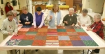 Members of the Comfort the Needy quilting group work together on a quilt Wednesday, March 3, at St. Peter Lutheran Church.