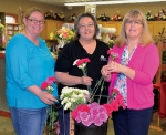 Andrea White and Denise James (from left), floral designers at Huntington Nursery & Florist, check out a bucket of carnations with Deanna Mills (right) a member of the Huntington County Right to Life carnation sale committee. Right to Life will sell the carnations on Mother's Day weekend, May 6, 7 and 8.