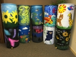The 2016 Rain Barrel Auction barrels pictured were painted by artists (bottom row, from left) Meghan McElhaney, Elyse Schuler, Betty Wallace, Angela Ellsworth and Kids Kampus; and (top row, from left) Ann Richard, Parkview Boys & Girls Club, Cassie Crider, Pathfinder Services-Creative Abilities and Ann Freds/JoEllen Morris.