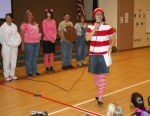 Flint Springs Elementary School Principal Aimee Lunsford (right) announces the results of the school's fund-raiser project during an all-school assembly Friday, Sept. 26.