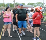 Stephanie Strickler (left) and Zak Strickler, of Fort Wayne, are among those taking their paces around the track at Kriegbaum Field during the 2019 Relay for Life. The 2020 Relay event will be postponed until 2021 due to concerns over the COVID-19 impact.