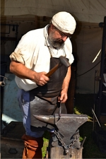 Mark Thomas, shown in his blacksmith shop at the Forks of the Wabash Pioneer Festival in 2013, will be the beneficiary of this year's Ride 2 Provide on Aug. 19 in Warren. In addition to a motorcycle ride, the day-long event at Markle Park features a silent auction, games and activities and a pulled pork dinner.