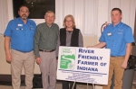 Steve and Judy Adams (second and third from left, respectively) received the River Friendly Farmer Award at the Huntington County Soil and Water Conservation District's annual meeting and banquet, held Tuesday, Feb. 27, in First Merchants Heritage Hall at the Huntington County Fairgrounds. With the Adamses are SWCD Vice Chairman Kyle Lund (first from left) and SWCD Chairman Andy Ambriole.