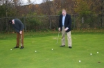 Eighth grade English Language Arts teacher Sam Wright (left) and Northwest Elementary School Principal Mark DuBois (right) took some of the first putts on the new Riverview Middle School putting green after its dedication on Oct. 21.