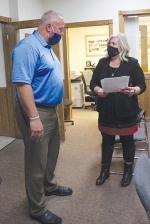 County Clerk Shelley Septer (right), swears in Roanoke Town Council member Nick Scheer. Scheer was selected by the council to replace Councilwoman Pam Parker, who has resigned from her position.