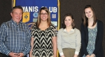 Rick Hartley, Roanoke Kiwanis Club president (left) stands with scholarship recipients (from left) Abby Blocker, Caitlin Ellis and Madison Carmichael.