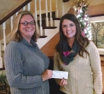 Kelly Schoenemann (left), of the Roanoke Tractor Pullers Association, presents Audrey Ehle, of Erin's House for Grieving Children, with a donation of $3,000, raised from the recent Roanoke Fall Festival tractor pull events.