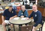 Organizers (from left) Doug Clark, of the Roanooke Lions Club; Lisa Southworth, manager of the Roanoke Lassus Brothers Handy Dandy store; and Ryan Carroll, of the Roanoke Volunteer Fire Department, go over plans for the upcoming Spirit Pump fund-raiser on Saturday, June 23, to benefit the RVFD.