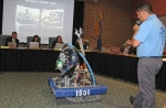 """Team T.H.R.U.S.T. mentor Chris Elston (right) introduces """"Invader"""" to the Huntington County Community School Corporation board members on Wednesday, Sept. 28. The robot was built by student members of the team."""