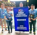 Members of Team 1501 T.H.R.U.S.T., the Huntington County 4-H robotics team, display the banner and trophies they received after winning a preliminary competition and advancing to the finals of the FIRST Robotics Competition's world championships. Team members are (from left) Josef Thomson, Brooke Elston, Connor Nash and Chris Elston. The local team concluded the competition with a seventh place ranking.