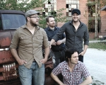 The local band Roustabout, comprised of musicians (from left) Justin Barker, Joey Spiegel, Chris Kauffman and Bob Thompson, will play the first Music in the City concert on Friday, May 4, in downtown Huntington.