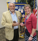 Newly-installed Huntington Metro Kiwanis President Dan Rumple (left) receives the gavel from Lisa Leist, the club's outgoing president.