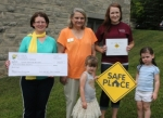 Heather Clampitt (left), philanthropic chair of Psi Iota Xi Phi Chapter, presents a check for $500 to Youth Services Bureau Executive Director Jan Williams (second from left) for the YSB's Safe Place program on Monday, Aug. 17. The donation was made at the YSB Safe Place site at Life's Little Treasures Daycare, located at Turn Pointe Community Church of the Brethren, in Markle. Also joining in on the celebration is (front) daycare pupils Vivian Branham and Katy Clampitt, and (back row at right) Alysia Marshall, co-director of the daycare center.