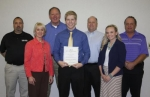 Lukas Kaylor (front row, center) is surrounded by representatives from the Smith family, Huntington County Safety Council and Transwheel, as he accepts the Robert J. Smith Memorial Scholarship in the amount of $1,000 on Wednesday, May 7.