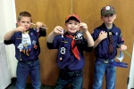 Winners in the Roanoke Cub Scouts' Raingutter Regatta were (from left) Isaac Conwell, second place; Jonny Fletter, third place; and Jakob Morton, first place.