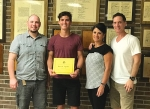Brock Spahr (second from left), a senior at Huntington North High School, was awarded a scholarship from the Rebels, Educators, Parents at Salamonie (REPS). With Spahr are (first from left) Joshua Heim, vice president, REPS; and (third and fourth from left) his parents, Monica and Mike Spahr.