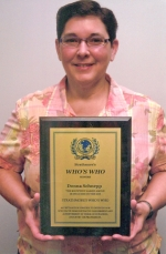 Donna Schnepp, of Huntington, holds a plaque designating her recognition by Strathmore's Who's Who, a register and global netweork for professionals who are outstanding in their fields.