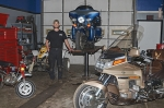 Chris Schroeder, of Schroeder's Automotive Specialists, in Huntington, stands in the middle of a few of the types of vehicles the shop is now repairing since it began complete cycle and ATV repair recently at its 1001 W. Park Drive location.