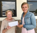 Judy Frischman (left), representing the Constance L. Schul Scholarship, presents a check to this year's winner, Meg McDonald. McDonald is planning to obtain a degree in biology/chemistry at Huntington University.